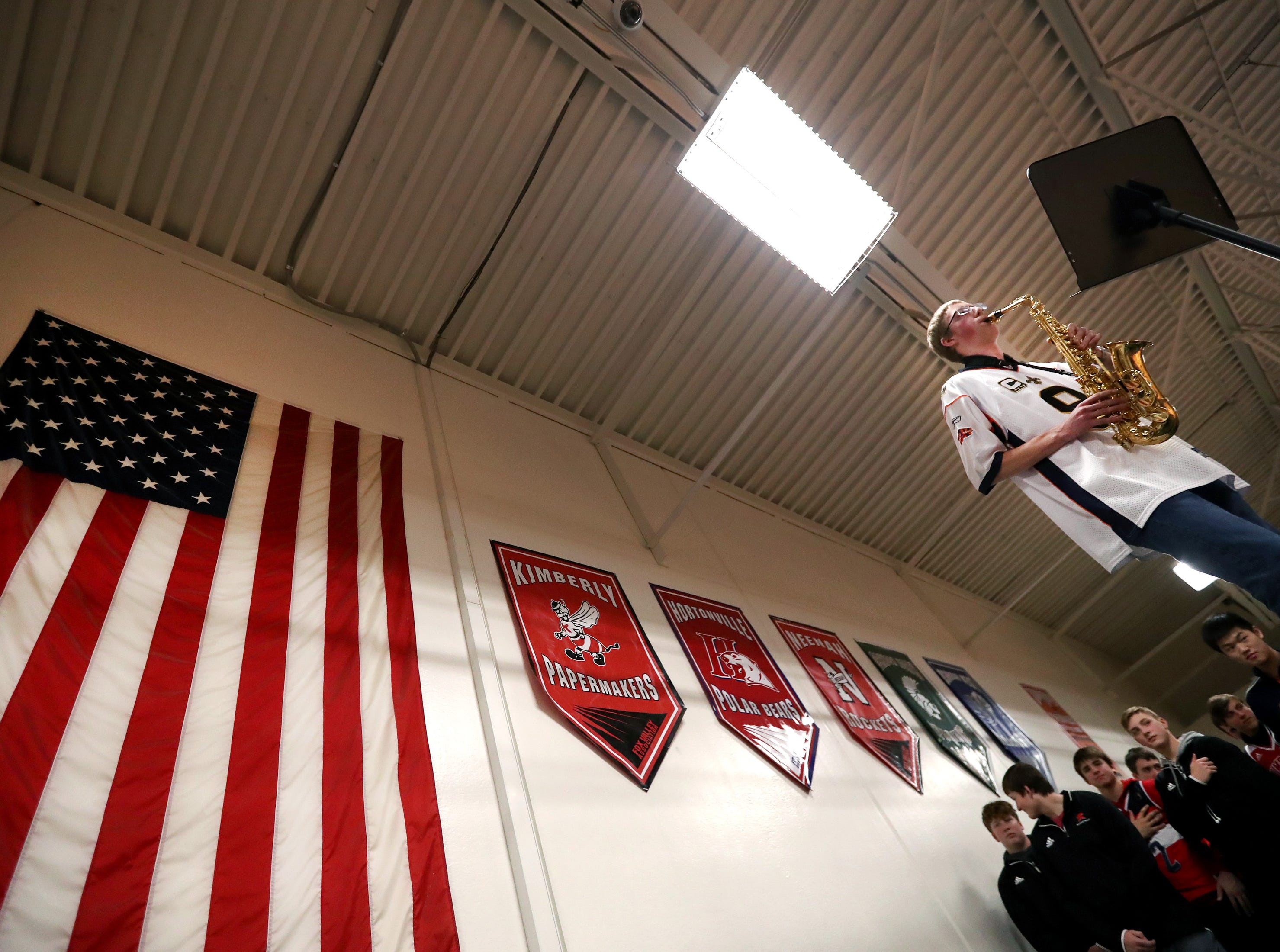 Collin Van Cuyk, a senior at Kimberly High School, performs the National Anthem on the Alto Sax before their game against Kaukauna High School Friday, Dec. 7, 2018, in Kimberly, Wis.