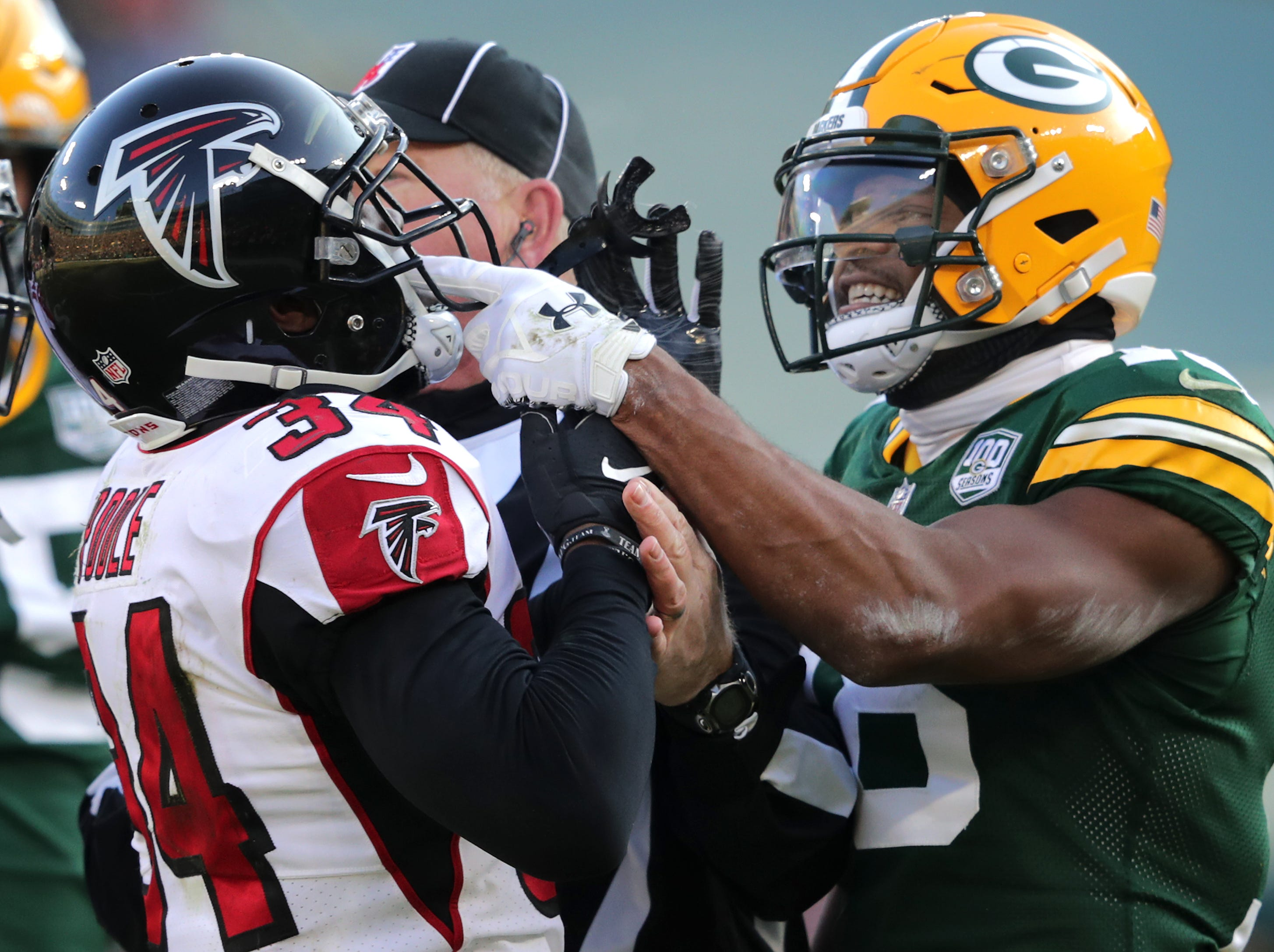 A scuffle between Green Bay Packers wide receiver Randall Cobb and Atlanta Falcons cornerback Brian Poole following Poole's tackle of Green Bay Packers quarterback Aaron Rodgers in the second quarter of the Green Bay Packers against the Atlanta Falcons during their football game on Sunday, December 9, 2018, at Lambeau Field in Green Bay, Wis.
