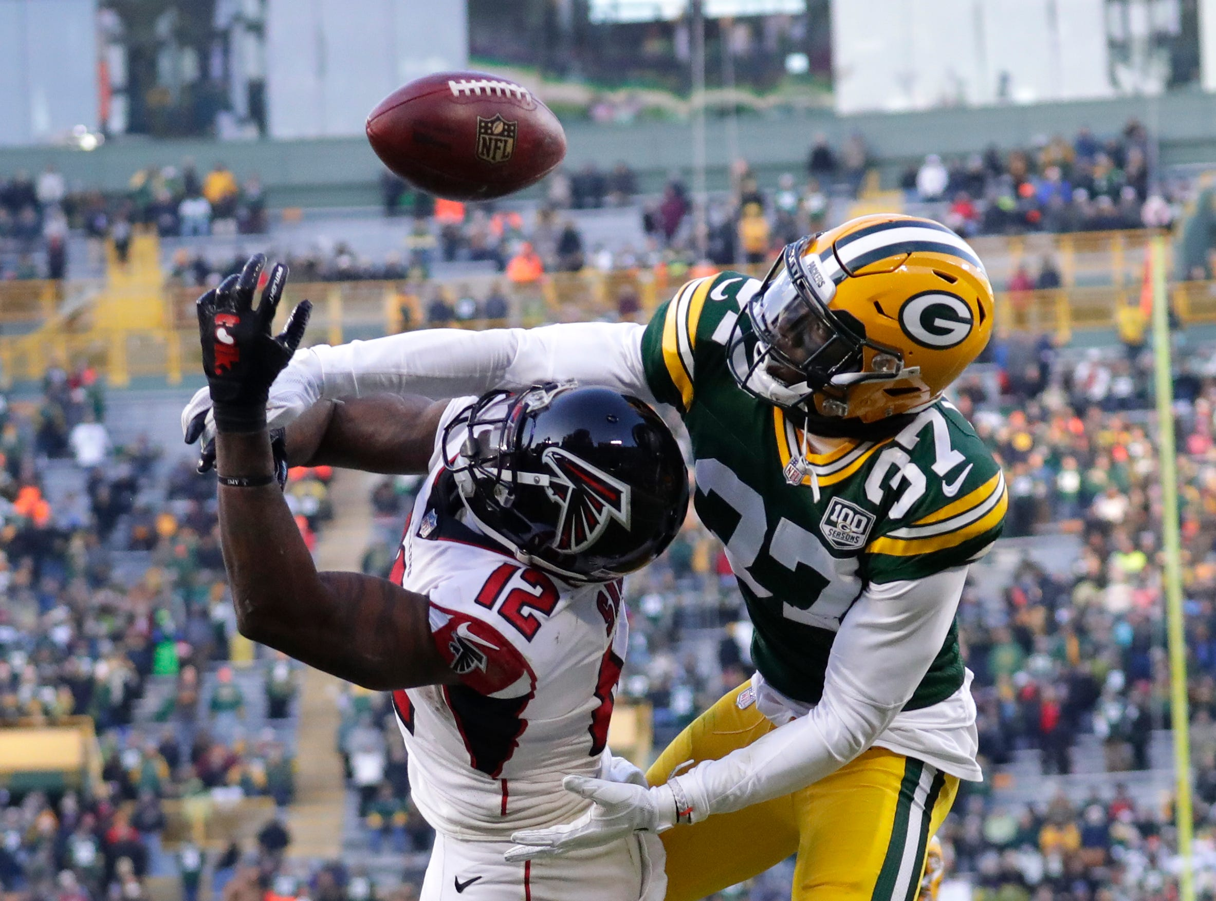 Green Bay Packers cornerback Josh Jackson (37) breaks up a pass in the end zone intended for Atlanta Falcons wide receiver Mohamed Sanu (12) late in the fourth quarter Sunday, December 9, 2018, at Lambeau Field in Green Bay, Wis. 