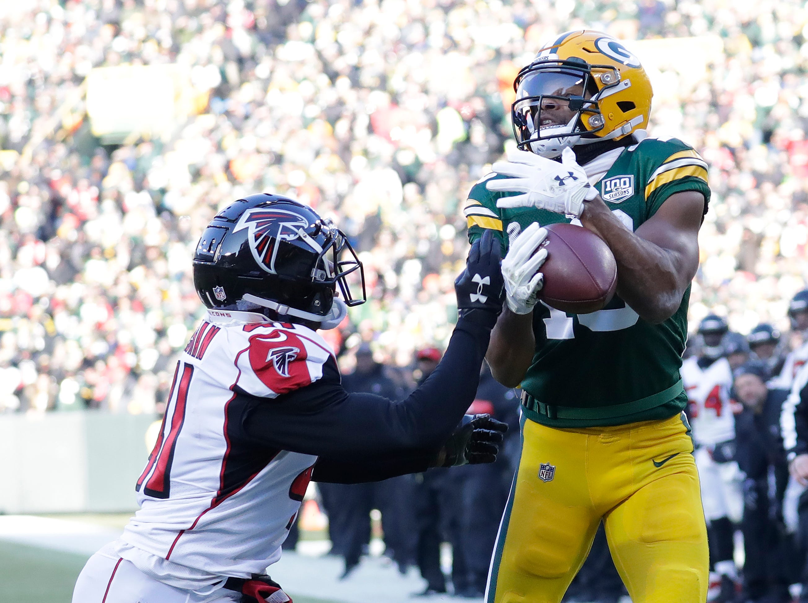 Green Bay Packers wide receiver Randall Cobb (18) scores a touchdown against Atlanta Falcons defensive back Sharrod Neasman (41) in the third quarter Sunday, December 9, 2018, at Lambeau Field in Green Bay, Wis. 