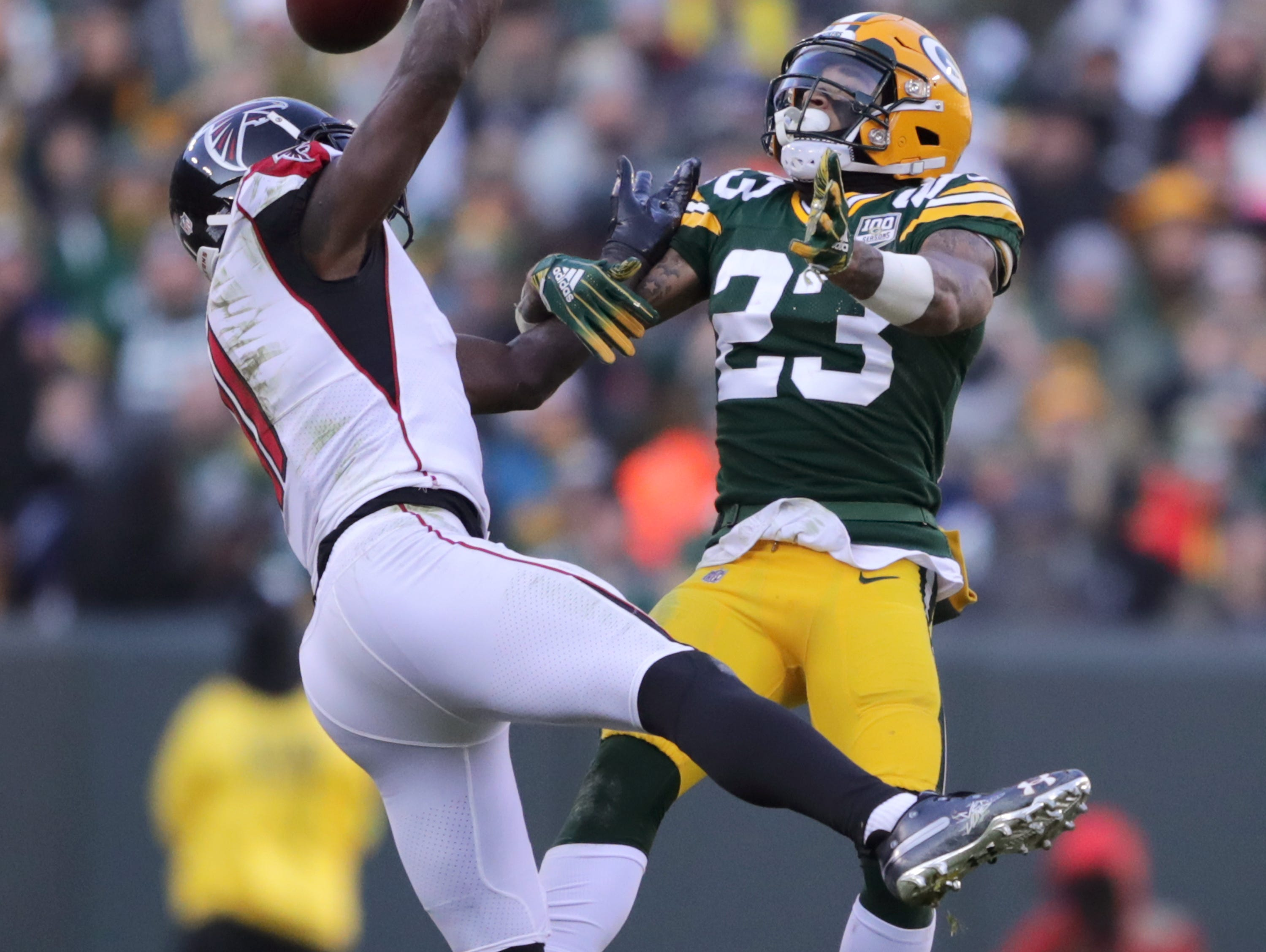 Green Bay Packers cornerback Jaire Alexander breaks up a pass intended for Atlanta Falcons wide receiver Julio Jones during their football game on Sunday, December 9, 2018, at Lambeau Field in Green Bay, Wis.