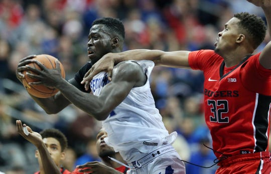 Seton Hall forward Ismael Sanogo (14) holds onto the ball as Rutgers forward Ibrahima Diallo (32) tries to make a steal.