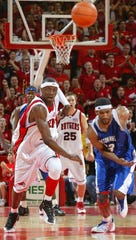 Rutgers' Herve Lamizana, and Seton Hall's Damion Fray chase a loose ball in the 2004 classic at the RAC.
