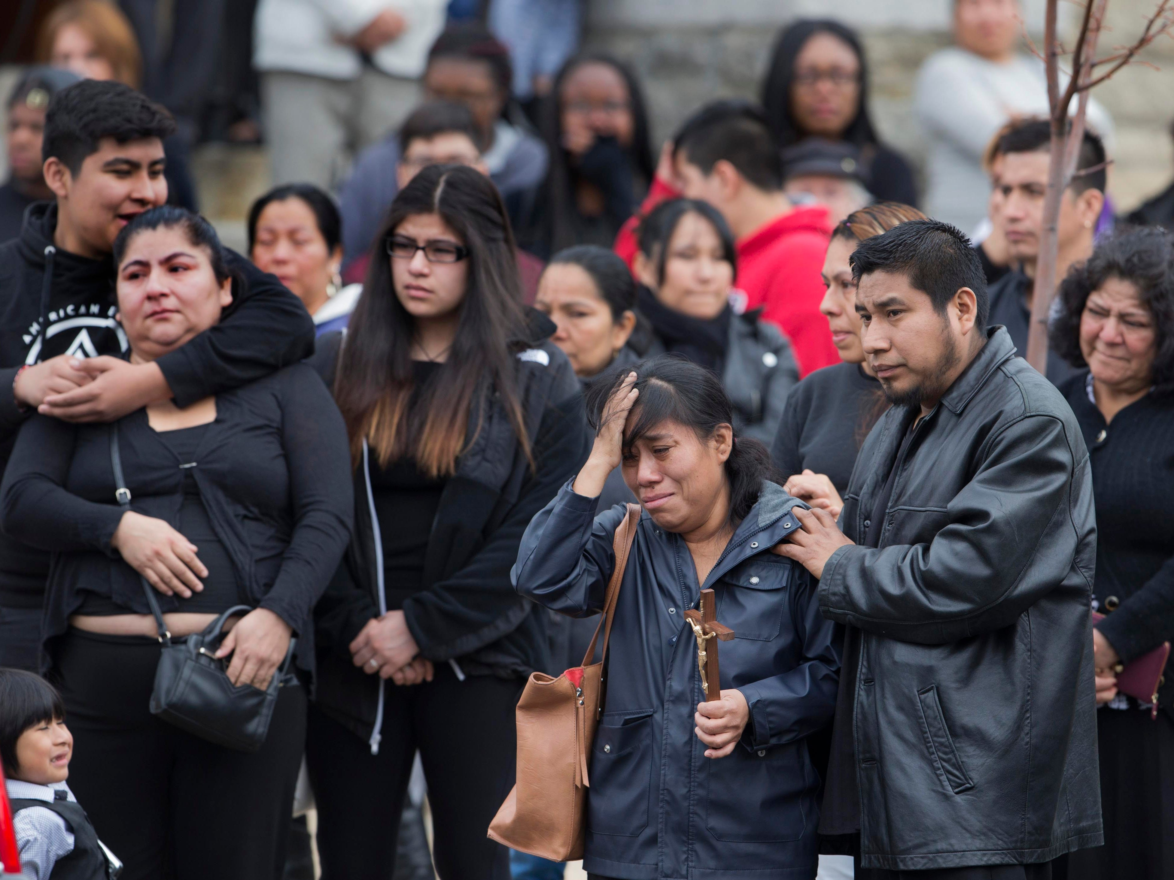 Mourners wait as the hearse is loaded with casket during funeral service for 10 year old Yovanni Banos-Mereno at Holy Spirit Roman Catholic Church.   The gunman was looking to shoot YovanniÕs older brother over a gang issue and the young boy was killed by a stray bullet.  3/1/2018