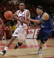 Rutgers'  Quincy Douby goes for a shot against Seton Hall's Donald Copeland  during the overtime in 2005.