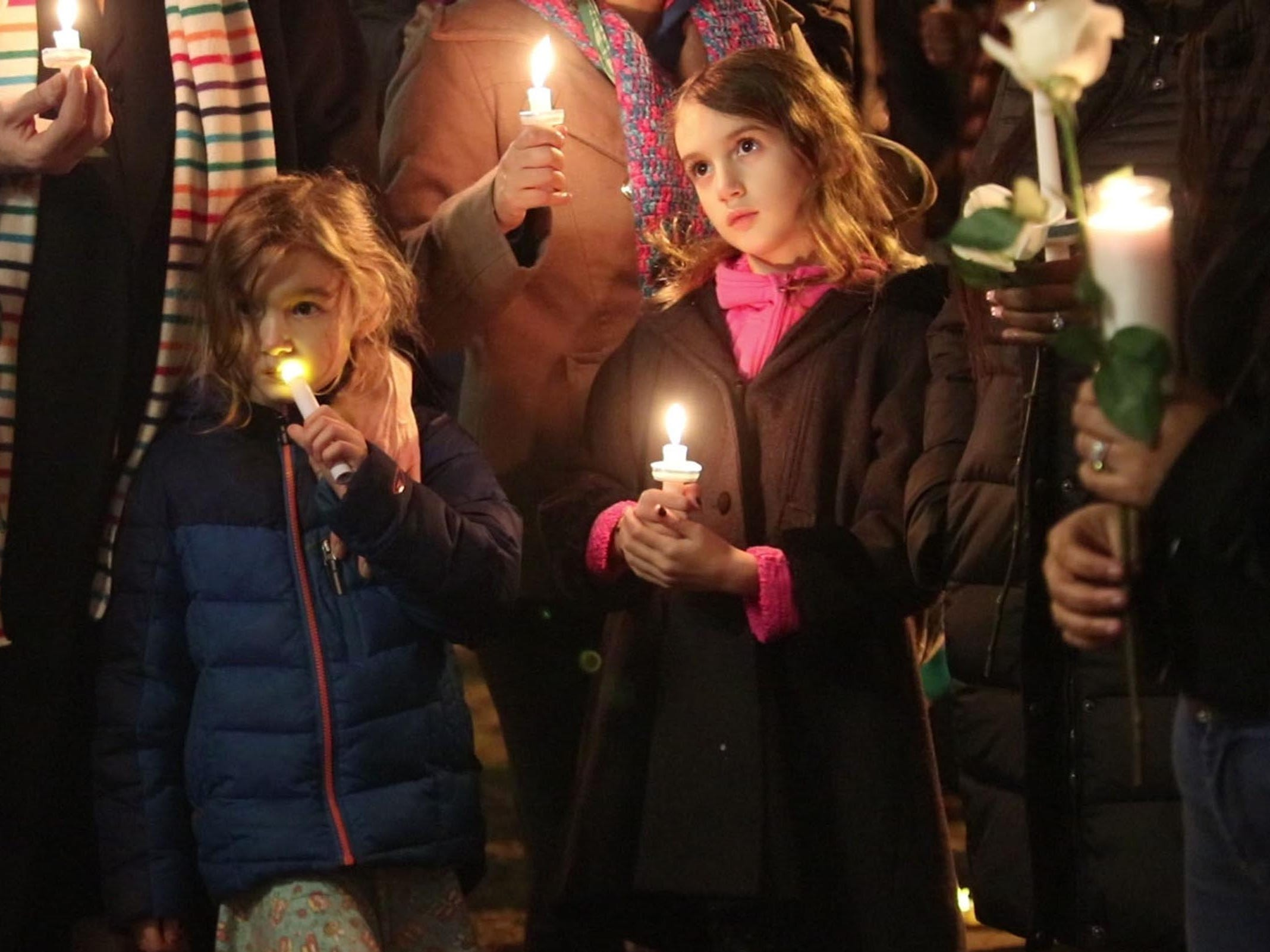 Mourners gather at the Boys & Girls Clubs of Monmouth County to hold a vigil for 10 year Yovanni Banos-Merino who was shot and killed this past week. Asbury Park, NJ on Saturday, February 24, 2018