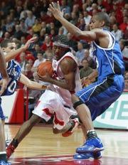 Seton Hall's Marcus Toney-El (right) defends against Rutgers' Juel Wiggan