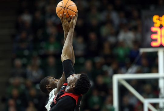 Michigan State Spartans forward Jaren Jackson Jr. (2) and Rutgers Scarlet Knights center Shaquille Doorson (2) fight for opening tip