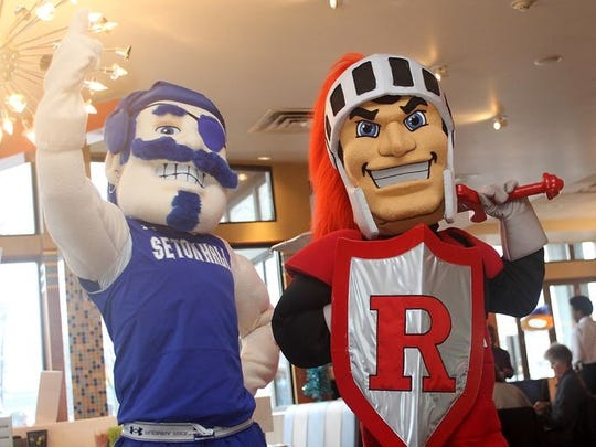 The Seton Hall Pirate and the Rutgers Scarlet Knight at a diner together.