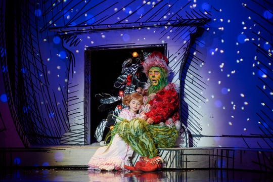 "Gavin Lee as The Grinch and Mackenzie Jane Mercer in ""How the Grinch Stole Christmas,"" hitting Madison Square Garden from Dec. 13 to 30."