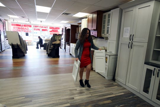 Mafalda Pereira and her father, Luis Pereira, co-owners of Devine Creations Design Center, a nine-year-old, family-owned kitchen and bathroom design business, showcase their new showroom in Red Bank, NJ Monday, December 10, 2018