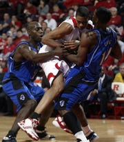 JR Inman of Rutgers is surrounded by Seton Hall's Brian Laing and Stan Gaines.