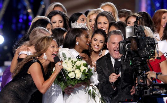 Miss America 2019 Nia Imani Franklin is mobbed from after she was crowned at Boardwalk Hall in Atlantic City, NJ, Sunday, September 9, 2018.