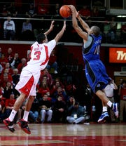 Jordan Theodore (right) beats MikeRosario to a loose ball at the RAC.
