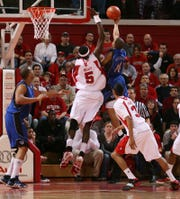 Hamady N'Diaye (left) blocks a Jordan Theodore shot at the RAC