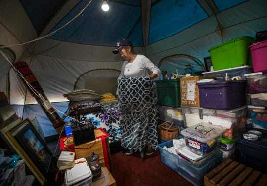 Camper Olga Savka starts packing up her tent as camp starts preparing for its eventual closing. The government sanctioned  homeless camp in southern Howell Township is closing soon. While there is no firm date, Reverend Steve Brigham is packing up what he wants to save of the supplies and tents and throwing the unwanted items into a dumpster. Much of the good items the campers don't use are regularly given to the poor at the town square in Lakewood.   12/22/18