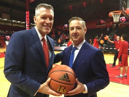 Seton Hall AD Pat Lyons (right) poses with Rutgers AD Pat Lyons before a 2017 game at the RAC