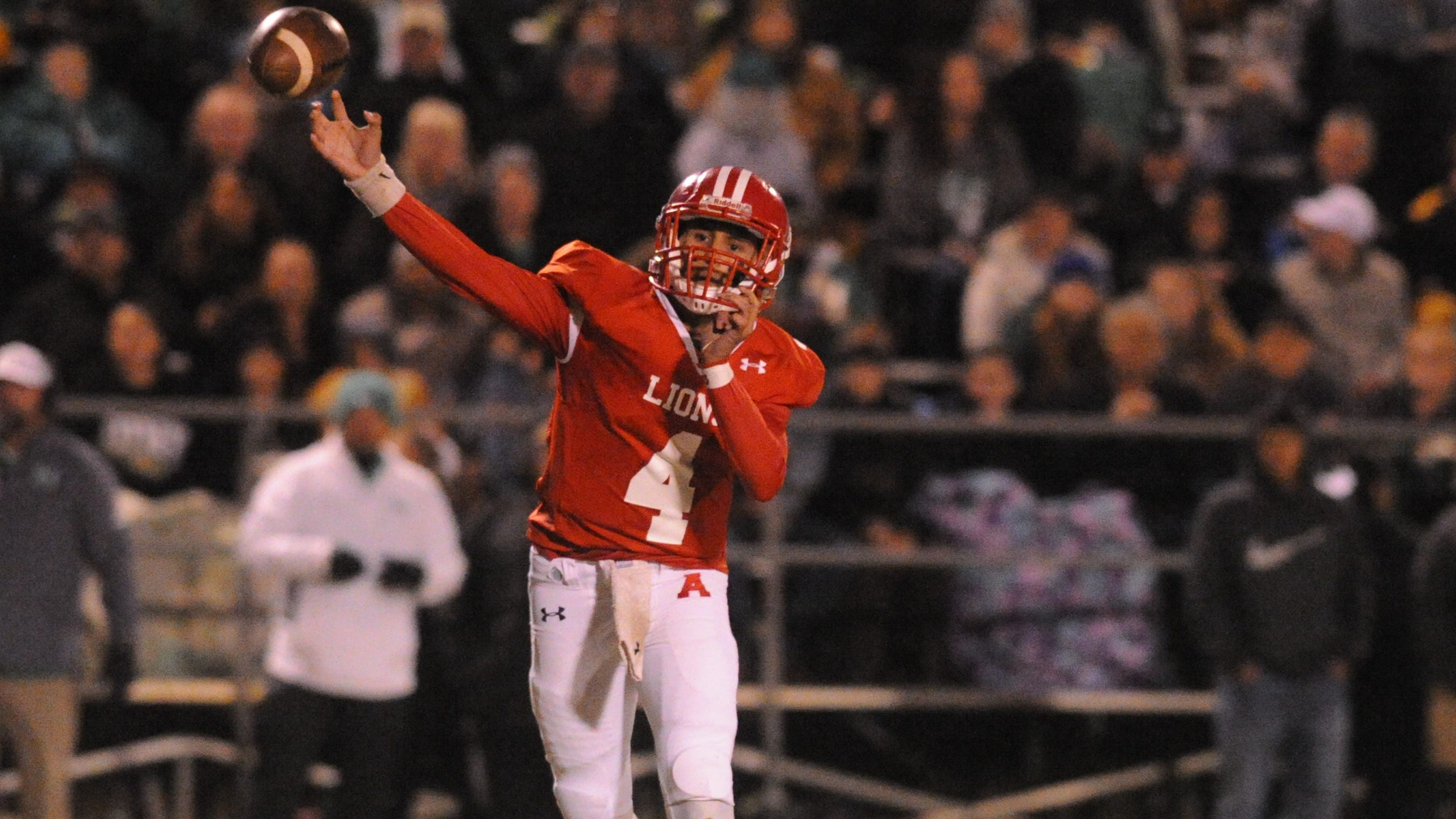 Albany junior quarterback Ben West throws a pass against Hamlin on Nov. 9, 2018, at Robert Nail Memorial Stadium in Albany. The Lions won the game 34-27 to earn the district title.