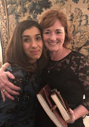 "2018 Nobel Peace Prize co-recipient Nadia Murad, left, with Suzanne Sims of Abilene after Murad was honored Monday in Stockholm. Suzanne and her husband, Danny, were invited by Murad to the event. Murad spoke in April 2017 in Abilene and calls Suzanne Sims her ""Christian mother."""