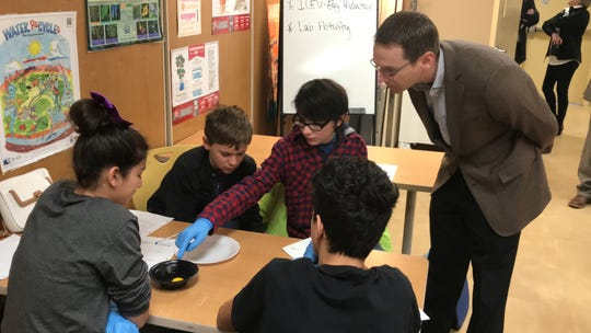 Mason Newman, a seventh-grade student in Roscoe, points out the egg yolk to Texas Education Commissioner Mike Morath while working in a group with Andrew Maitland, Zoie Montgomery and Marcus Hernandez on Thursday. The biology class was studying chicken eggs upon Morath's visit to the Edu-Vet facility operated by the Roscoe Independent School District.