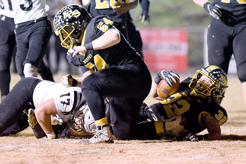 Murphy senior Slade McTaggart lays on the ground after being taken down by Robbinsville following a run during the NCHSAA 1A West regional final at Murphy High School on Dec. 7, 2018. Seconds later McTaggart was ejected from the game for kicking another player.