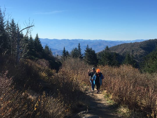 Angela Shepherd and Tanya Cummings of the hiking group Pathways to Parks make their way up Waterrock Knob Trail off the Blue Ridge Parkway in November.