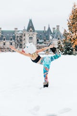 Anastasiia Ostapovich poses for photos at the Biltmore Estate in Asheville after a snowfall on Sunday, Dec. 9, 2018.