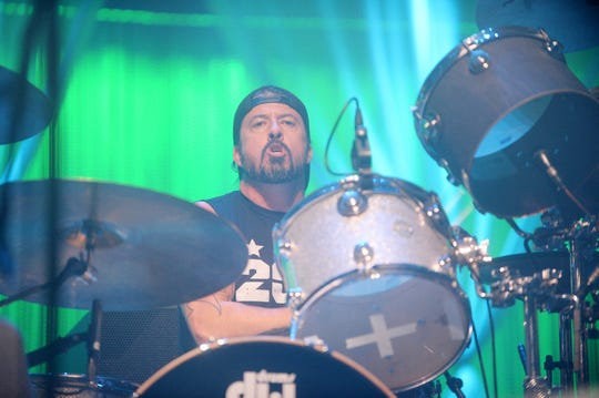Rocker Dave Grohl plays the drums during a December 2018 performance for Christmas Jam at Asheville's U.S. Cellular Center. Grohl is best known as being the lead singer of The Foo Fighters and for being the drummer in Nirvana until Kurt Cobain's death in 1994.