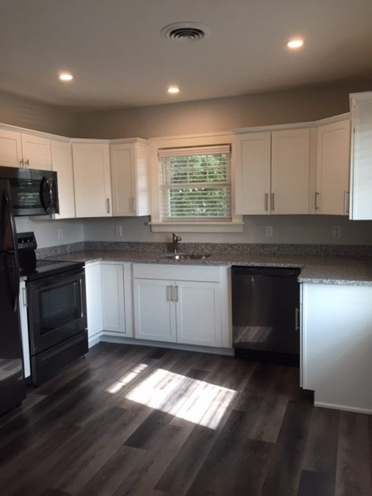 The finished kitchen at 724 Capital Ave. SW. The developer received $40,000 through the city's Rental Rehabilitation Program to turn space above an office into an apartment.