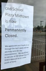This note hangs on the dining room doors at Old School Pizza's midtown location.