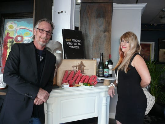 OPEN: Robert Busse and Kim McMillan recently opened the Living Room Art Gallery & Wine Bar in downtown Melbourne.