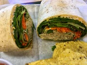 The chicken salad wrap at Peach in the Garden Cafe in Rockledge contained finely minced chickenwith a touch of Latin flavor rolled with shredded carrots, lots of greens and a thin layer of cheese below the tortilla.