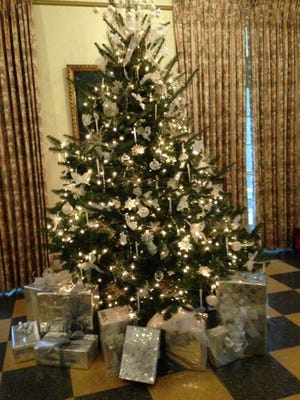 This 7-foot Fraser fir tree, all deckedin white, can be viewedin the mansion at Kingwood Center Gardens. TheEarth, Wind and Flowers Garden Club decorated it for the holiday season.
