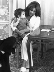A young Kris Gruen sits on the lap of singer Tina Turner.