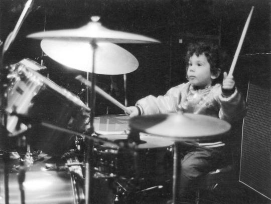 Kris Gruen plays drums at age 4 before a late set at a New York Dolls show at Max's Kansas City in New York.