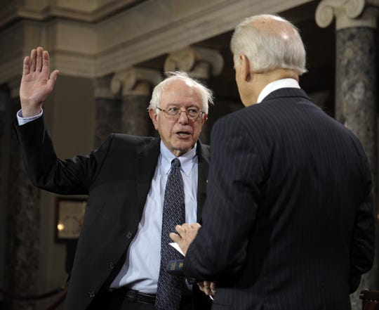 Vice President Joe Biden administers the Senate Oath to Sen. Bernard Sanders, I-Vt. during a mock swearing in ceremony on Capitol Hill in Washington, Thursday, Jan. 3, 2013, as the 113th Congress officially began.