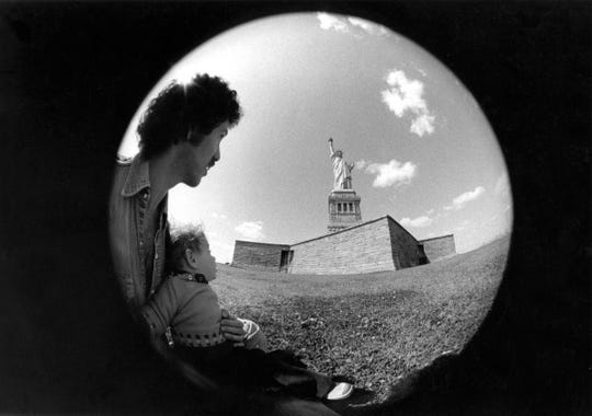 Kris Gruen with his father, music photographer Bob Gruen, at Liberty Island in New York City in 1976.