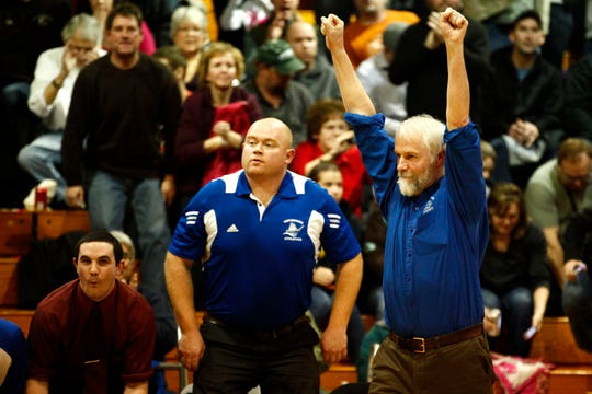 Vergennes coach Peter Quinn throws his arms up in celebration after the final whistle in the 2012-2013 regular-season finale. The Commodores completed a perfect 20-0 campaign and then went on to win the D-II championship.