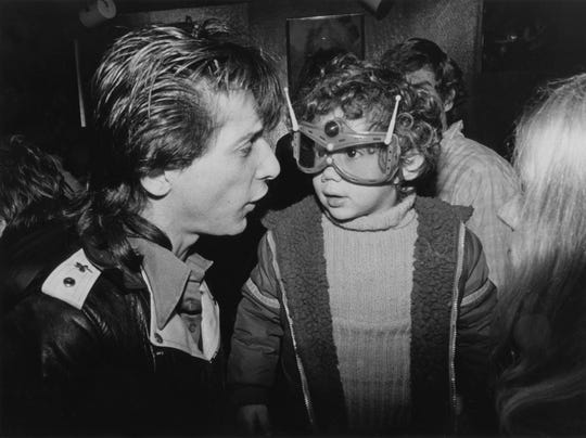 "A young Kris Gruen dons fancy eye wear as he talks with New York Dolls guitarist Johnny Thunders at Max's Kansas City in New York. ""Gosh, you can't put your arm around a memory,"" Gruen wrote in an email to the Burlington Free Press, ""but this is darn close."""