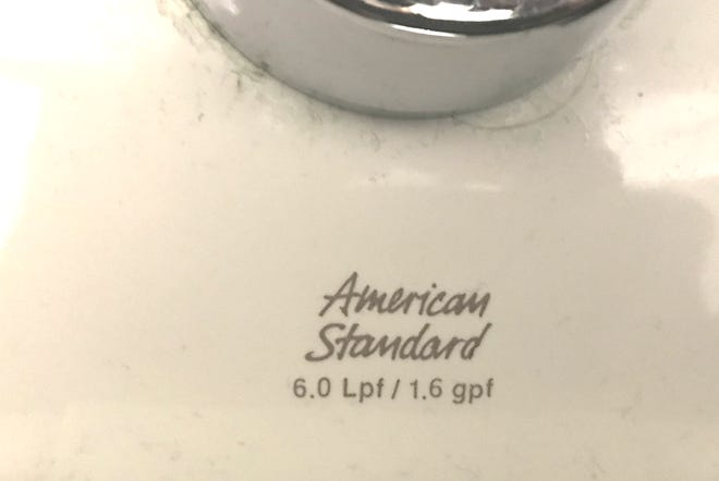 Below its brand name, a toilet lists its gallons per flush in liters (Lpf) and gallons (gpf). The 1.6 gpf standard became the mandated maximum for flush toilets in 1994. Newer toilets operate efficiently with 1.28 gpf. Photographed Monday, Dec. 10, 2018.