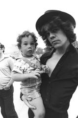 David Johansen of the New York Dolls holds a young Kris Gruen.