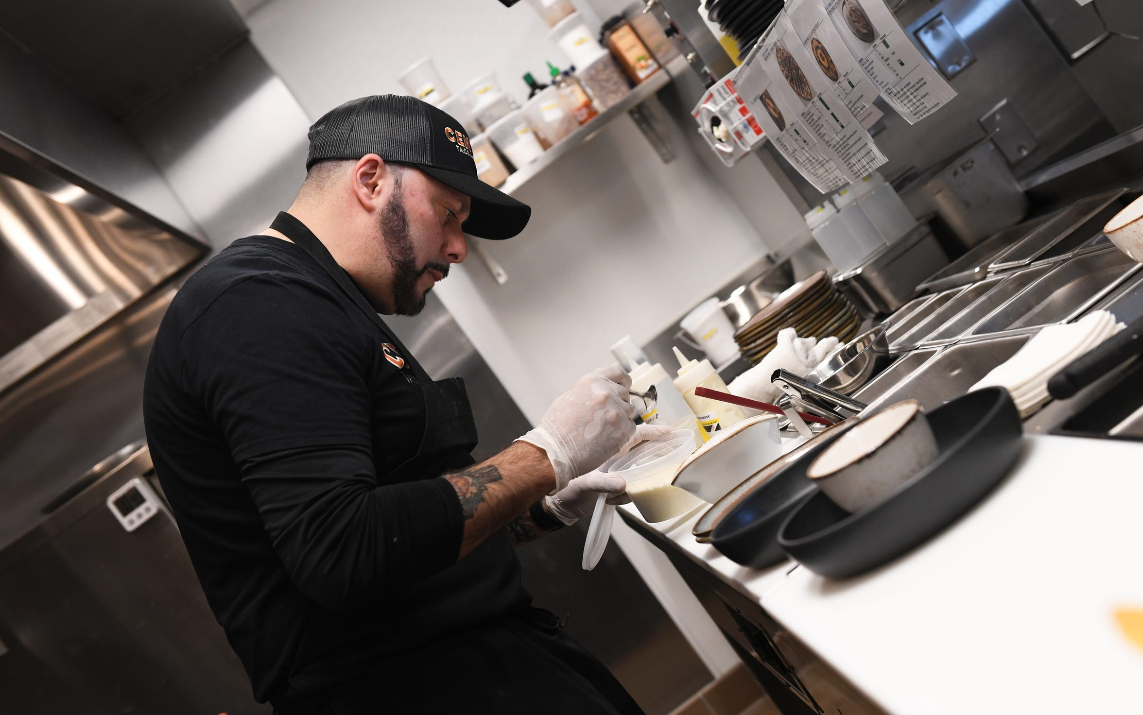 P.J.W. Restaurant Group Executive Chef Rich Friedrich prepares  Mexican street corn at Central Taco And Tequila in Westmont.