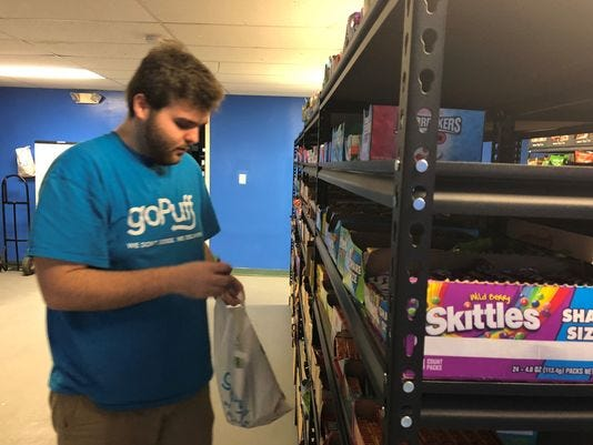 Conor Fox, operations manager, fills an order at goPuff's warehouse in Cherry Hill.