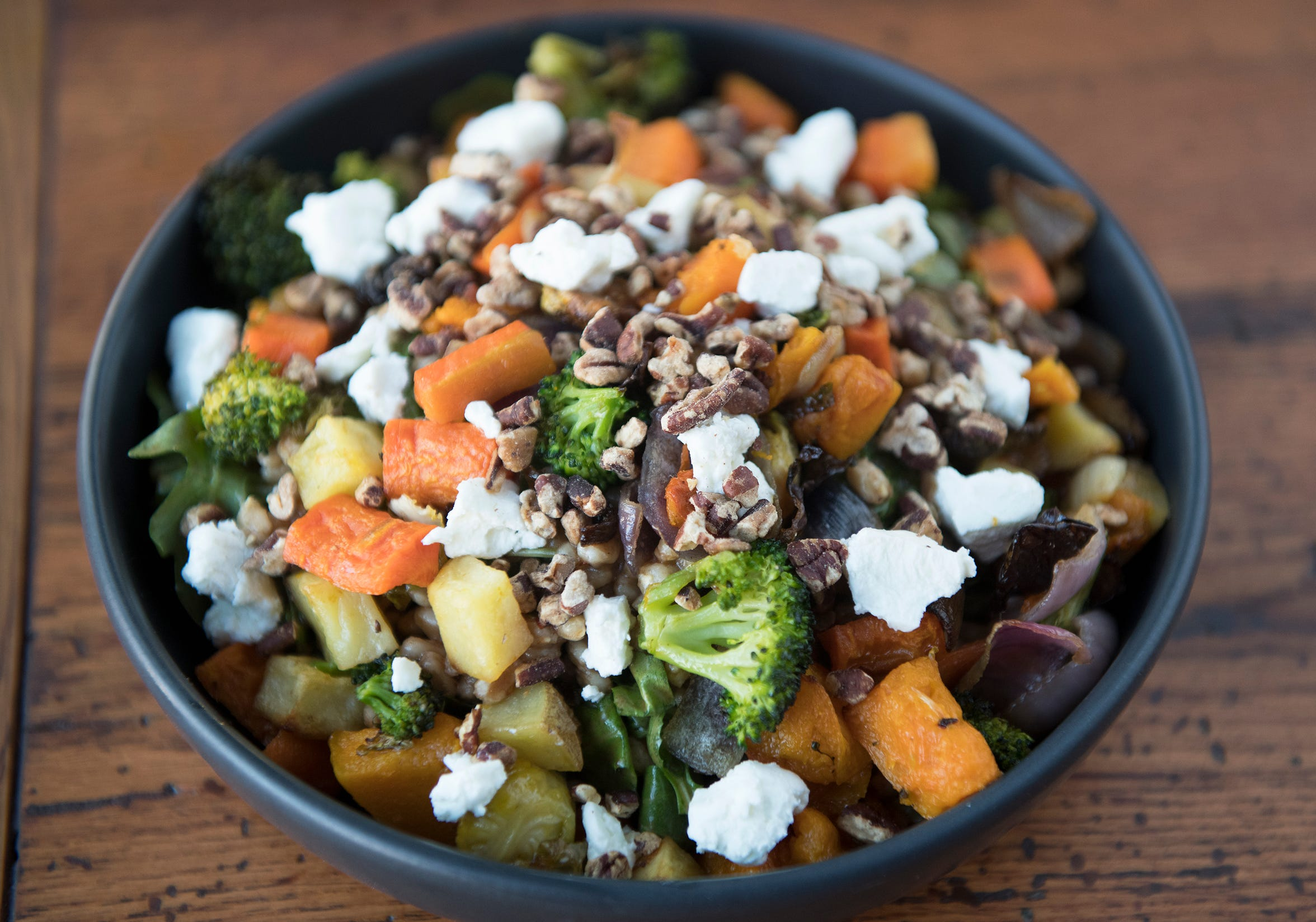 Mercado Ensalada offers a healthy bounty of roasted vegetables, toasted pecans and a chipotle balsamic vinaigrette.