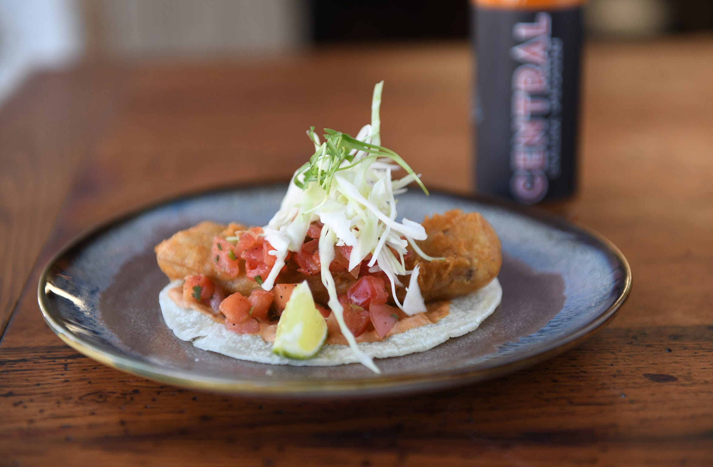 A Crispy Fish Taco is among the many options for seafood lovers at Central Taco and Tequila.