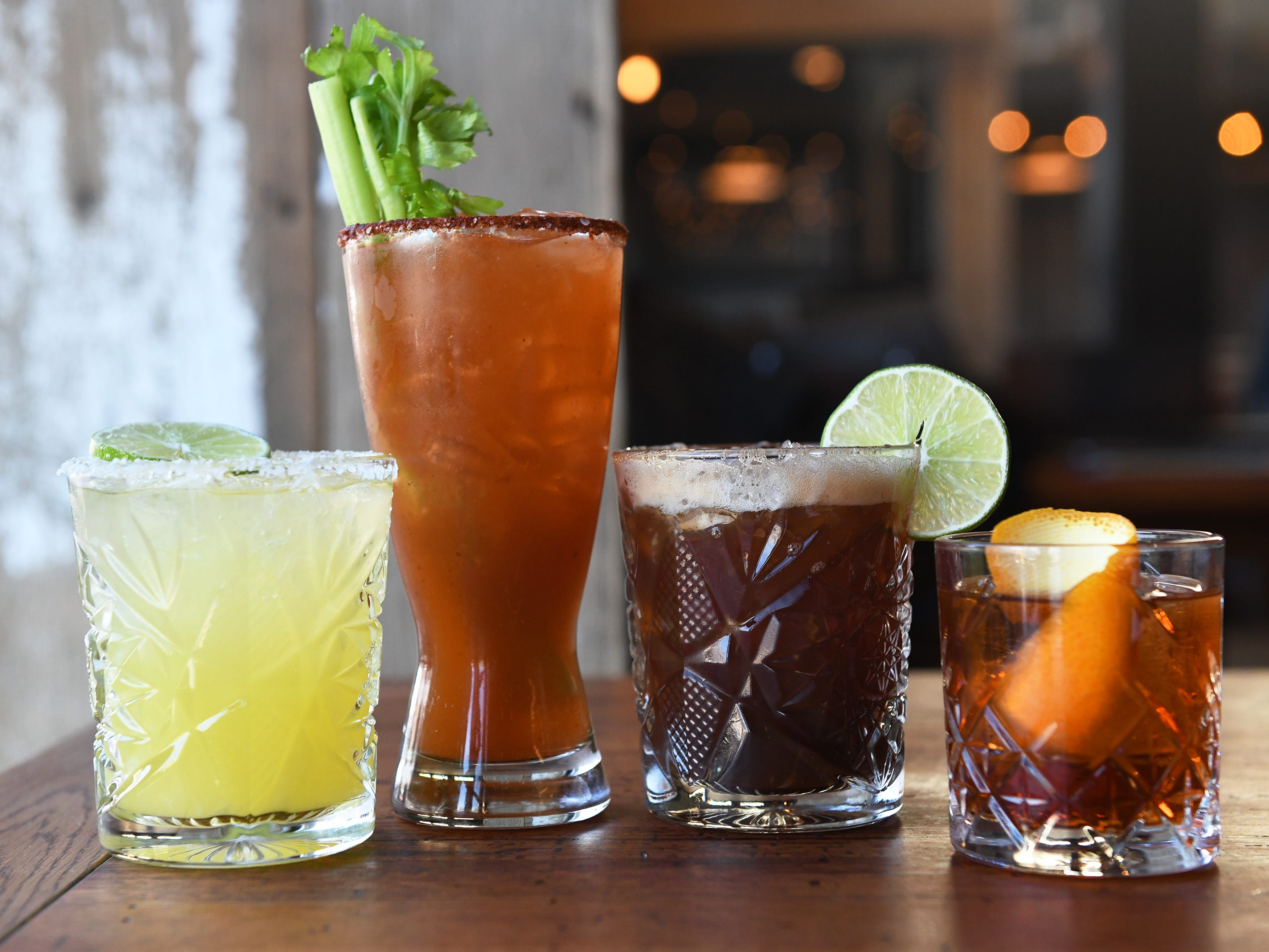(From left to right): A Central margarita, a michelada,  a cold brew margarita, and an Oaxaca Old Fashioned are displayed at Central Taco And Tequila in Westmont.
