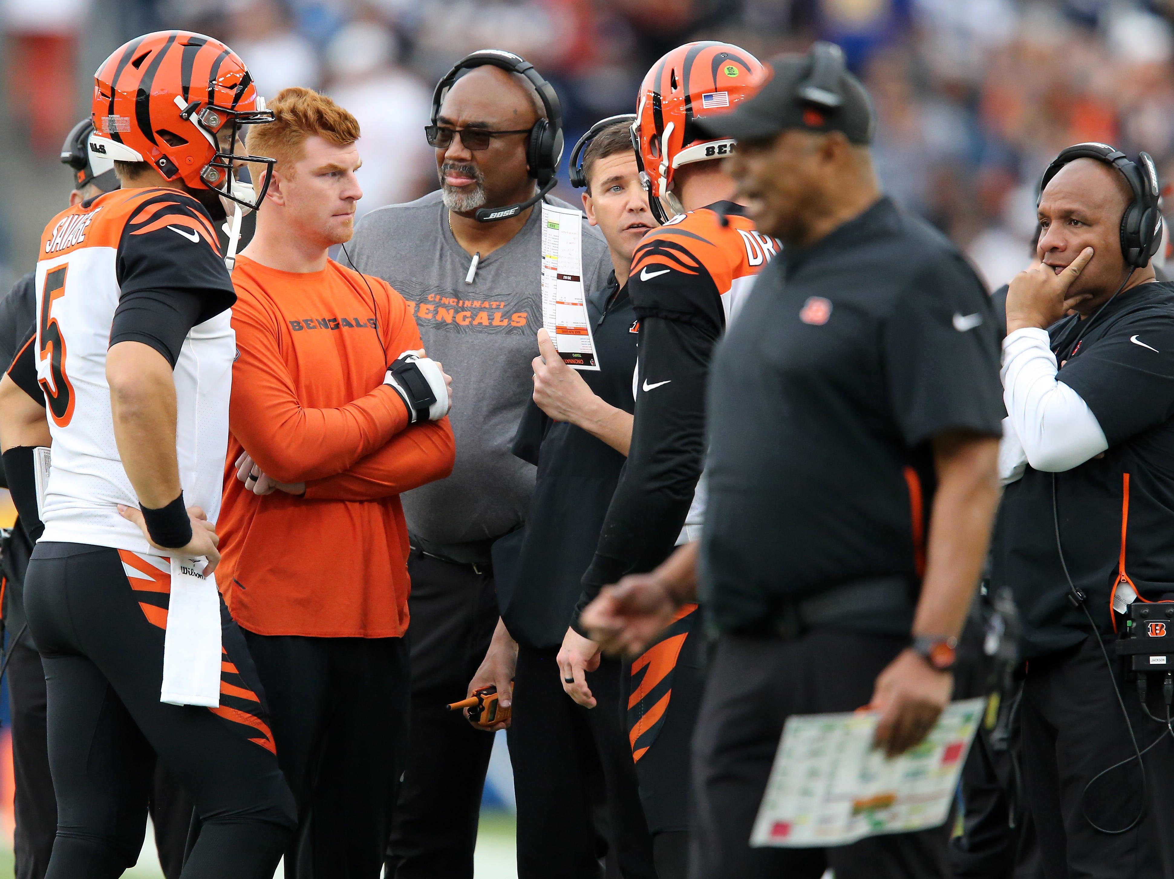 Cincinnati Bengals offensive coordinator Bill Lazor, center, talks with Cincinnati Bengals quarterback Jeff Driskel (6) in the fourth quarter of a Week 14 NFL football game, Sunday, Dec. 9, 2018, at StubHub Center in Carson, California. The Los Angeles Chargers won 26.21.