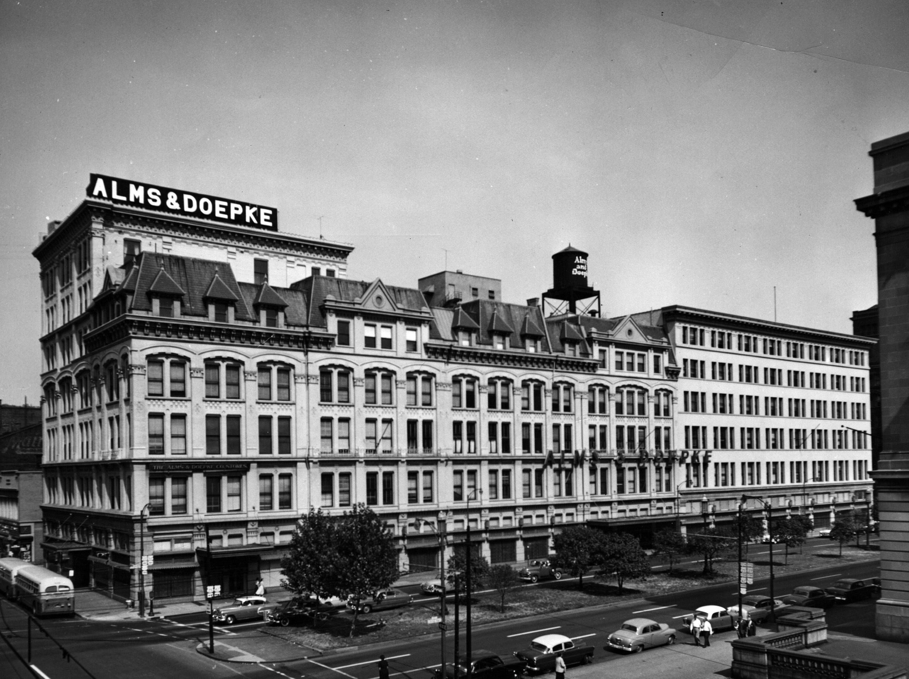 The Alms & Doepke department store, shown here in 1955, filled an entire block along Central Parkway from Main to Sycamore. The massive store was built in stages, with buildings designed by Samuel Hannaford and Daniel Burnham.
