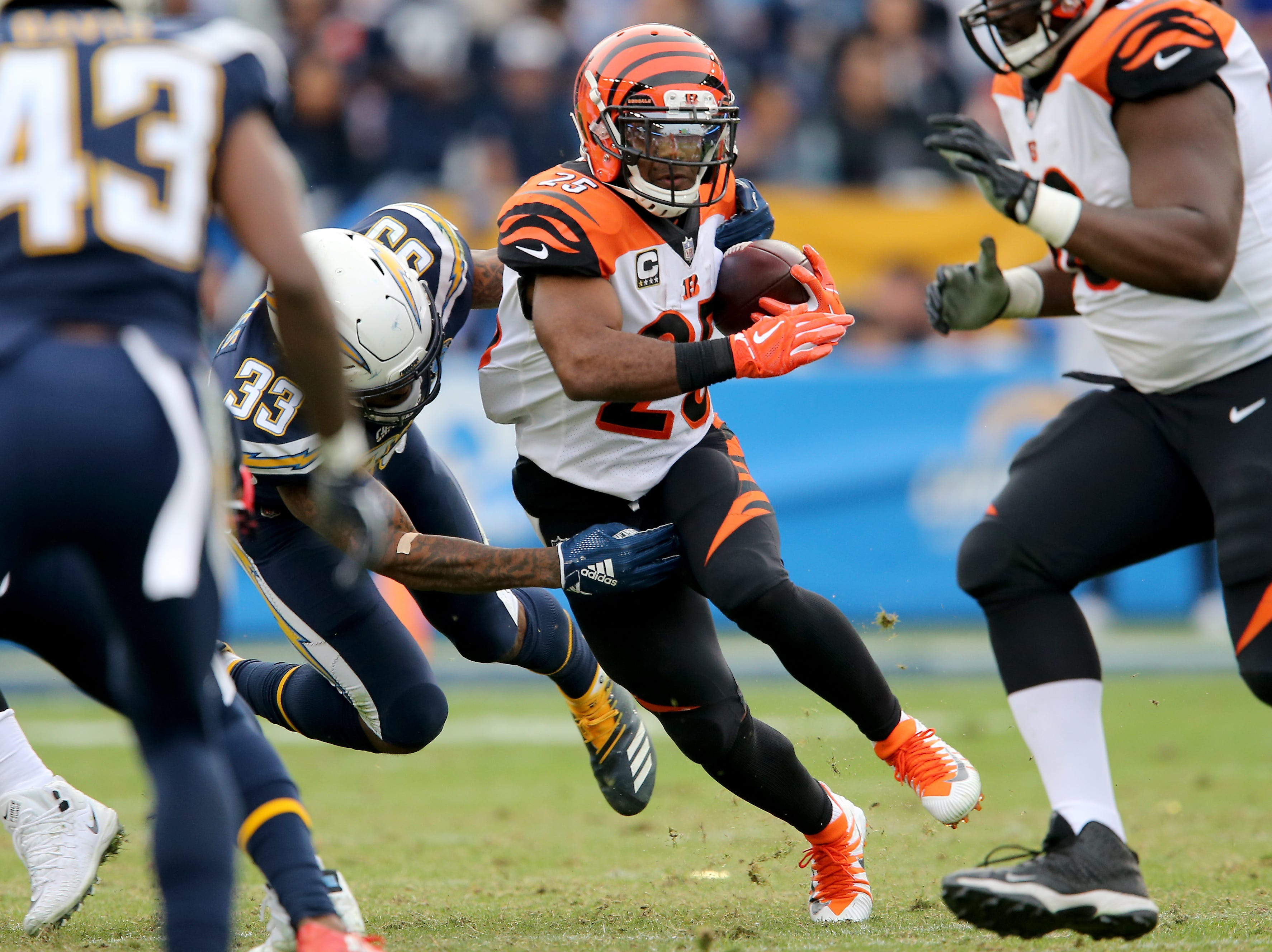 Cincinnati Bengals running back Giovani Bernard (25) carries the ball in the third quarter of a Week 14 NFL football game as Los Angeles Chargers free safety Derwin James (33) defends, Sunday, Dec. 9, 2018, at StubHub Center in Carson, California.