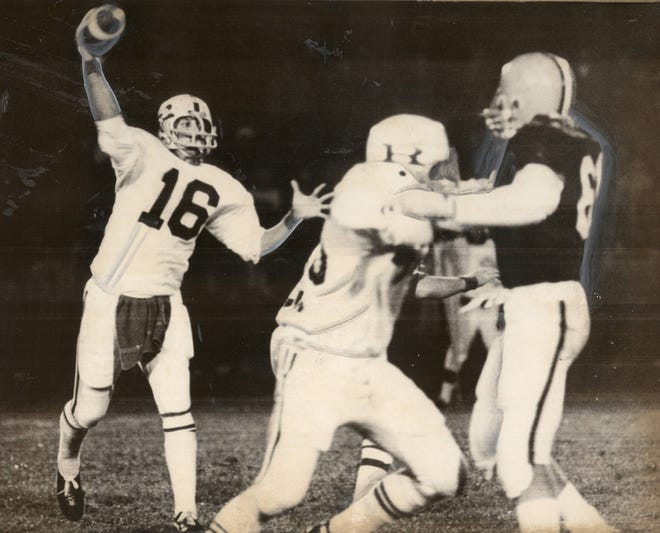 NOVEMBER 16, 1973: Lancaster, Ohio: Looking for a receiver. Cincinnati Reading quarterback Randy Christophel (16) looks for a receiver as he releases a pass during first quarter action in the Class-AA semi-final contest against Ironton at Lancaster. Blocking on the play was Tom Grippa (45) against Ironton's Daryl Dalton (82).